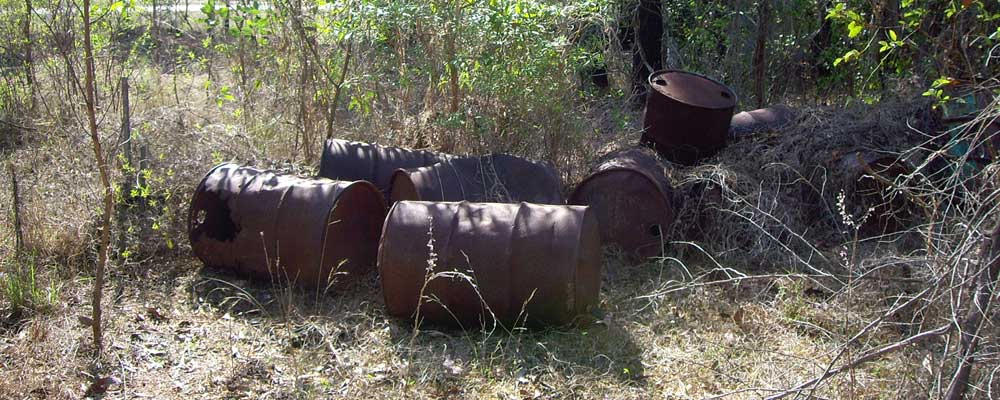 Petrol drums on contaminated site