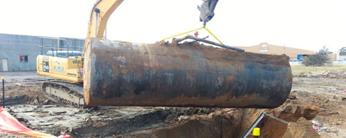 Removing a fuel storage tank from the Masters site