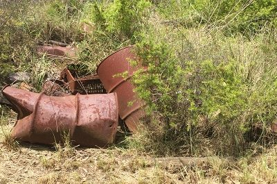Old barrels on left on a contaminated site