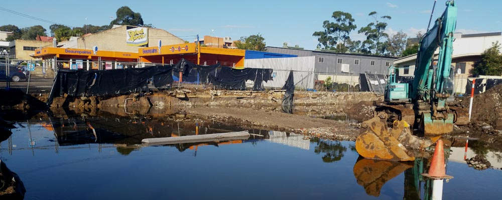 Rain inundates ALDI remediation site